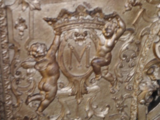 Detail of one monarch coach. Two angels holding the crown