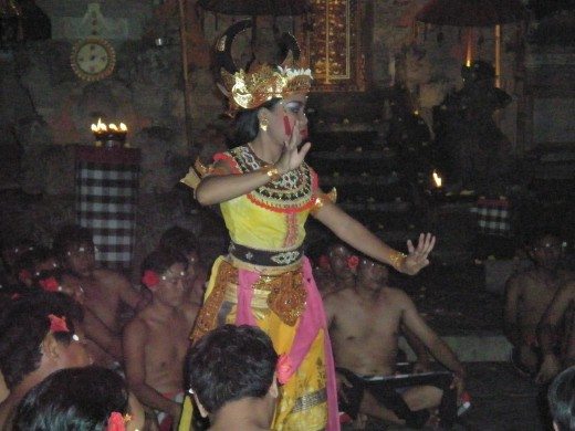 The Bali dance is performed within the circle formed by the choir of a hundred men.  Ubud, Bali, Indonesia.