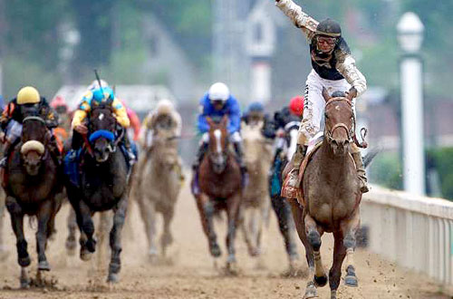 Horses run in the Kentucky Derby at Churchill Downs