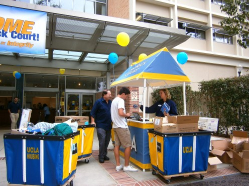 Moving carts and checking in--move-in day can be busy and crazy.