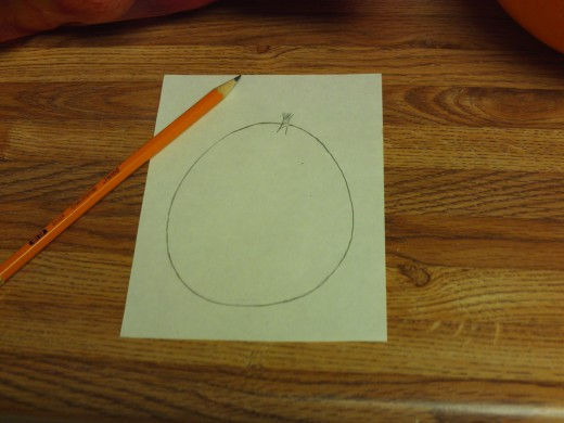 Here I am beginning to draw the outline of the pumpkin for the Thanksgiving Day card.