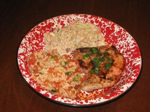 My sofrito rice with slaw and a Cuban pork chop.