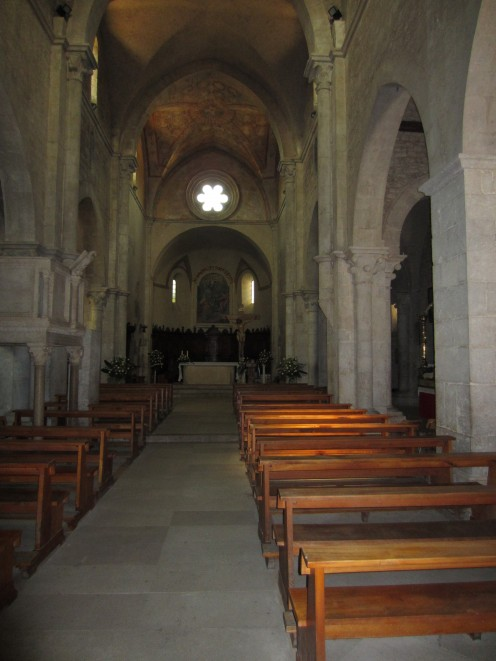 The main aisle in the church of St. Mary of the Assumption leading to the main altar;  Amaseno, Italy