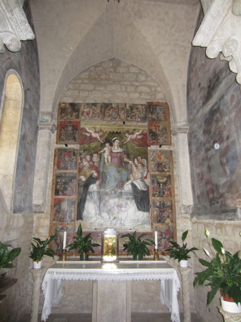 One of the altars in the church of St. Mary of the Assumption in Amaseno, Italy