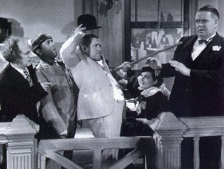 Publicity photo for The Three Stooges short subject Disorder in the Court. Copyright Columbia Pictures, 1936. Used to illustrate film being described.
