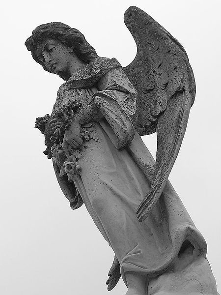 A statue of an angel at a cemetary in Metairie Cemetery in New Orleans, Louisiana