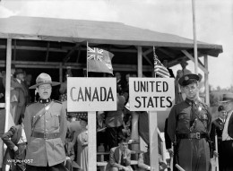 """""""OIL PIPELINE - HIGHWATER, P.Q. A Royal Canadian Mounted Police officer and a State Trooper are on duty on their respective sides of the border as welders from both countries connect the 236-miles (sic) pipeline connecting a tanker terminal at Portla"""