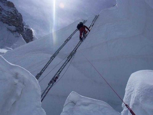 Crossing a crevasse on the Khumbu icefall is a difficult challenge for climbers on the Southeast Ridge.