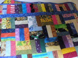 This rail fence quilt is a scrap quilt that uses any and all fabrics.