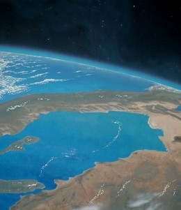 Planet Earth, Baja California (Painting by Carl Martin. Part of the Auriga constellation and Capella in the background. Psi-5 Aurigae remains off the top of the image.)
