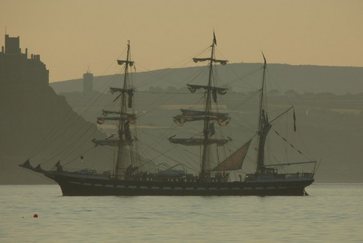 A tall ship in Mounts Bay off Penzance with St Michael's Mount in the background