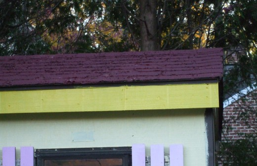 The roof paint is different than the original brown shingle color, but it works.