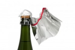 What is the best way to uncork a champagne bottle without bubbling over?