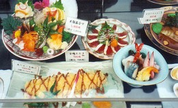 Molded plastic food replicas on display outside a restaurant in Japan