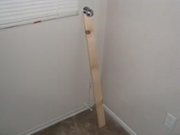 Wood brace wedged under door knob secures door from being kicked in.