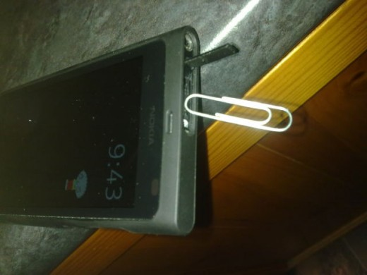 Paperclip hanging off the magnetic point that holds the usb port cover on the N9