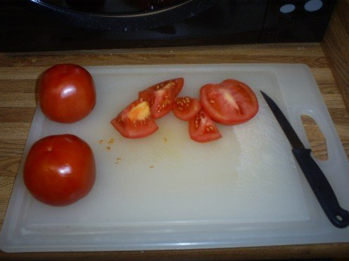 Chop up three organic tomatoes.