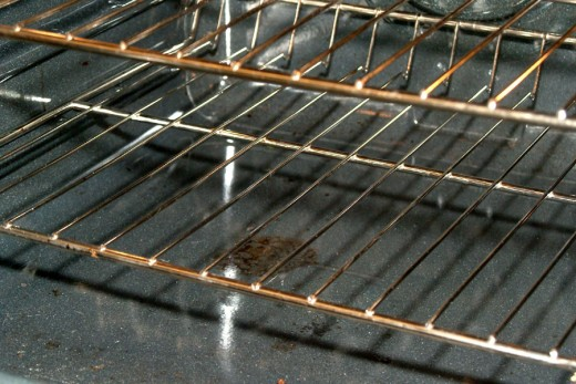 A dirty oven floor needs some Green Cleaning!