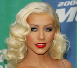 Christina Aguilera's Hairstyle.The swept and curled front locks combine well with the extreme curls in the back that are arranged on both sides