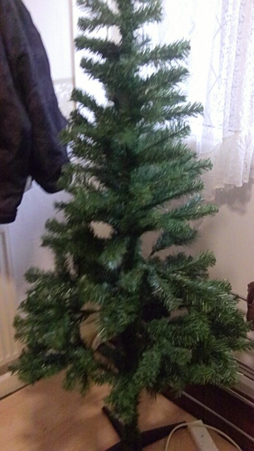 Assemble Your Christmas Tree first which is quite obvious and spread all the larger branches out.