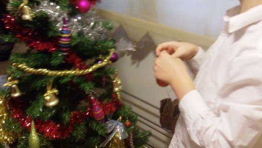 My Son tries to decide where to put his first Bauble....Hmmmm decisions, decisions!