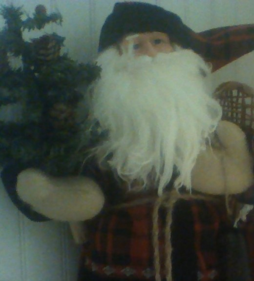 Father Christmas with pine tree and snow shoes
