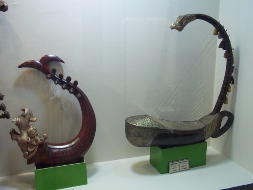 The second one is 'Vrischika Veena' i.e. veena in the shape of a scorpion. Note the strings are tied longitudinally.