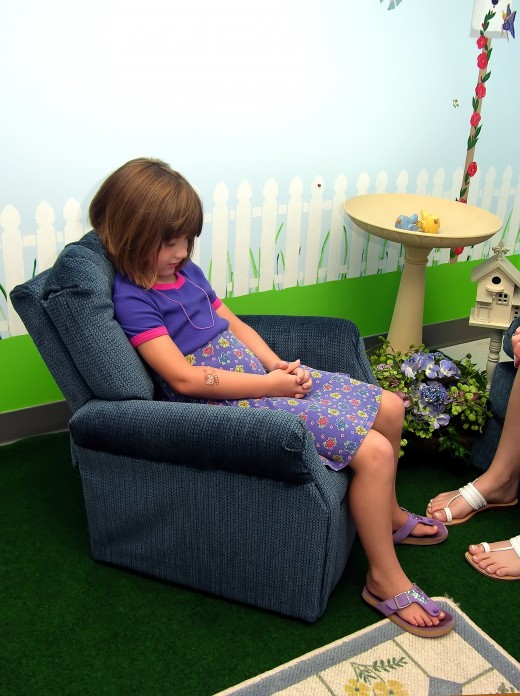 Child participates in group therapy.