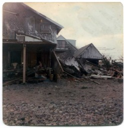 The remaining 2/3 of one cottage and the rubble of the boat house and the second cottage