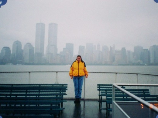 Me on the ferry with the twin towers in the back ground.