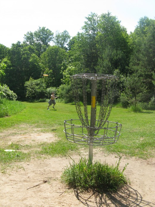 Disc Golf Putting - See how the disc pops more when it's got the blue sky for a background?
