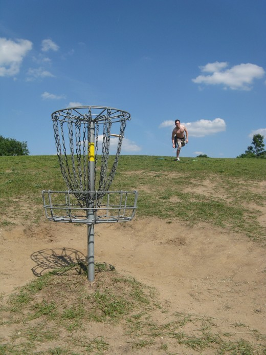 Disc Golf Putting - This is easily my favorite spot to take putting photos.  The pin is downhill and on a beautiful day the background for the shot is perfect.
