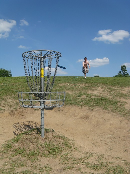 Disc Golf Putting - I'm not quite at the right angle to capture the action here.