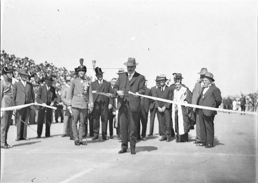 Jack Lang, watched by Sir Philip Game, cuts official ribbon, 19th March 1932