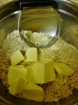 Cut in the chilled butter and blend into the oatmeal mixture.