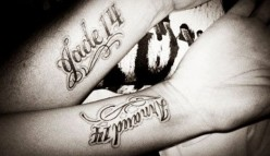 Names are popular couple tattoo design ideas.