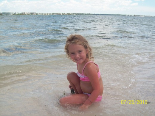 My granddaughter at a Gulf beach. Photo by Holle Abee.