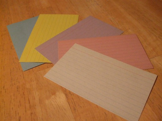 Colored note cards.  Note cards are a heavy card stock paper which hold a fold easily.