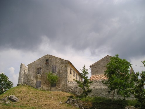 Clouds hang over Hum, Croatia, the smallest town in the world.