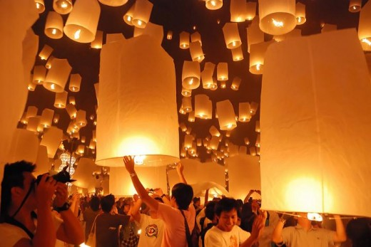 Floating lanterns in Loi Krathong festivities in Chiang Mai, Thailand.