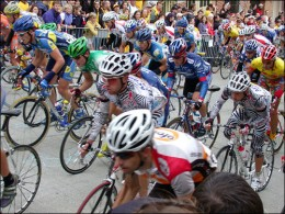 Lance Armstrong (centre in blue behind guy in zebra print) climbing a hill out of the saddle- you can tell they're all working hard against gravity