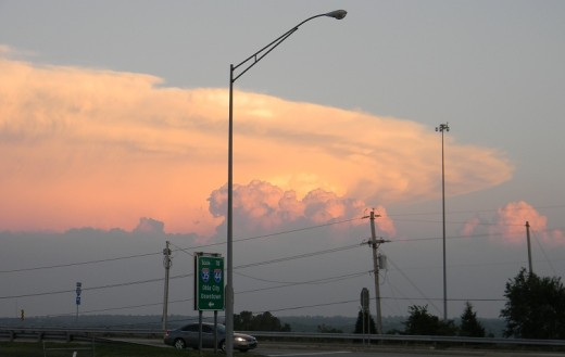 This stormy anvil cloud at sunset bore tornadoes that damaged large areas of rural central Oklahoma.