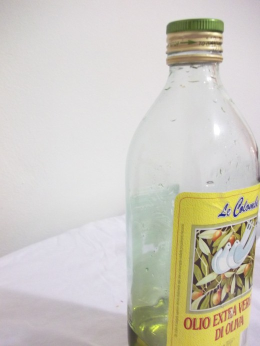 Transparent Bottle of pale green Olio Di Olive