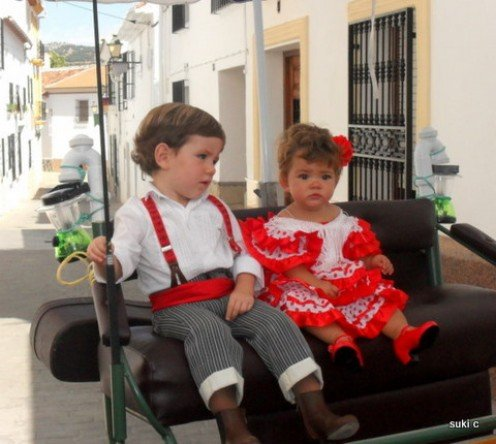 Two young party-goers at a fiesta in the white village of Alfarnate.