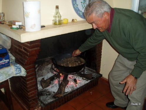 Our neighbour cooking Christmas lunch in the traditional way over an open fire.