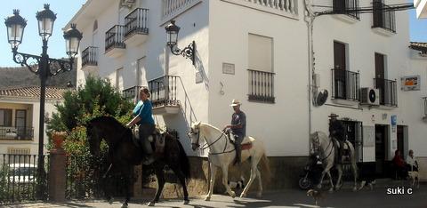 Horse riding through the white village of Riogordo.