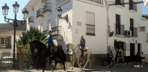 Horse riding through the white village of Riogordo.