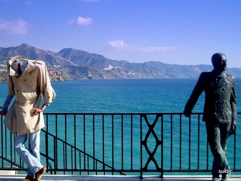 On the Balcon de Europa at Nerja - the statue of King Alfonso X11 - with a street performer!