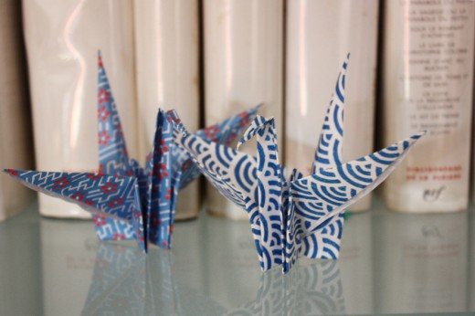 Even paper cranes can be used in a bedroom decorating scheme.