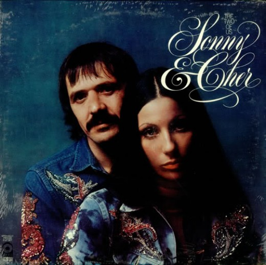 Sonny and Cher posing for the camera together.